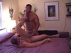 Bear's ass is so tight that he easily milks his buddy's cock until it erupts on him
