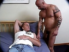 This guy awakes to see a hung bear waiting to plow his ass with his thick prick
